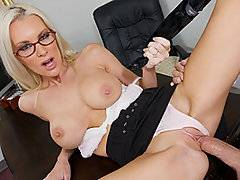 Now this is one stunning milf!  Beautiful and busty blond Brandi Edwards is disappointed with the performance of her employee, porn star Talon.  She calls him into her office, intending on giving him a good dressing down.  However, when the attractive stud walks into the room, she finds herself overwhelmed with lust.  She teases him by spreading her legs and showing off her pantie-clad vagina.  Soon she is naked except for her high heels, looking up at him through her glasses while she blows him.  She takes a hard pounding, riding the dick and getting nailed from behind while she is bent over her own desk.  Finally Brandi swallows a fat load.