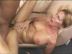 Nasty breasted blonde milf moans when black dude fucks her hard.