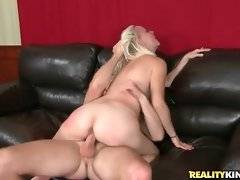 Big tited blonde milf sits down on stiff bone.