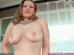 Hot shaped mommy Vicky Vixen slowly strips for camera.